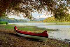 Red canoe on beach at river Danube Stock Images