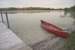 Red Canoe Beached On Lake Royalty Free Stock Images