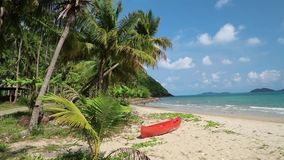 Red canoe on the beautiful tropical beach. With palm trees stock video