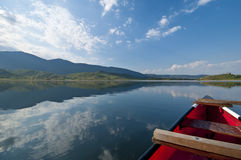 Red canoe in lake Stock Photo