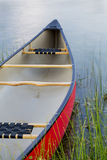 Red canoe on lake Stock Photography