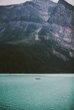 Red Canoe at Lake Louise. Banff Alberta Canada Royalty Free Stock Photos