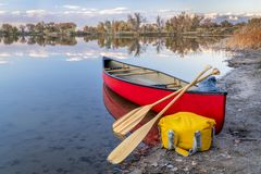 Red canoe on a lake shore royalty free stock photos