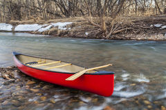 Red canoe on a river Royalty Free Stock Image