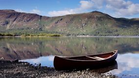 Red Canoe. A timelapse video of a red canoe on the banks of Derwentwater. In the background is Catbells a fell in the English Lake District National Park stock footage