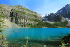 Red Canoe on Turquoise Lake - Banff, Canada Royalty Free Stock Photography