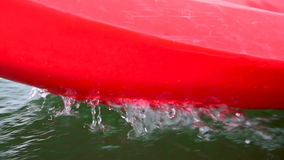 Red canoeing splashing water. stock video footage