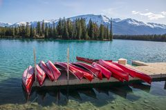 Red Canoes on a dock stock photos
