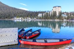 Red canoes at Lake Louise with rocky mountain in Banff national park stock photos