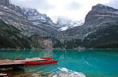 Red canoes at Lake O'Hara, Yoho National Park, Canada Royalty Free Stock Image
