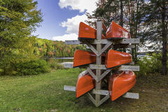 Red Canoes on a Rack Royalty Free Stock Photography