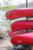 Red Canoes for Rental on Rack Stock Photo