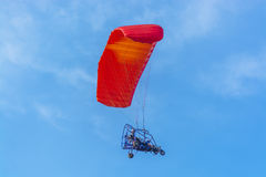 Red canopy powered tandem para glider Stock Photo