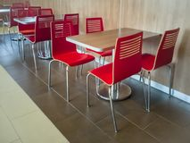 Red canteen diner chairs and tables stock photos