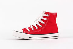 Red canvas shoes. On a white background Stock Photography