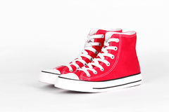 Red canvas shoes. On a white background Stock Images
