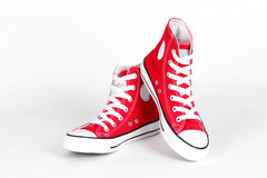 Red canvas shoes. On a white background Royalty Free Stock Images