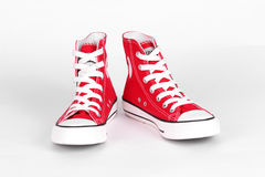 Red canvas shoes. On a white background Royalty Free Stock Photo
