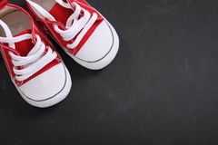 Red canvas shoes in the corner of blackboard Stock Photo