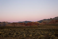 Red Canyon Mountains on Purple Sunset. Pre sunrise purples and reds enriching the reds and browns of the desert in Nevada, outside Las Vegas Stock Images