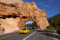 Red Canyon Roadway Arch. Cars driving through the roadway arch in Red Canyon near Bryce Canyon in Utah Stock Photos