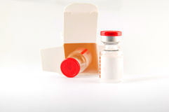 Red cap injection vial in container box Royalty Free Stock Photo