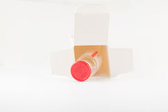 Red cap injection vial in container box Royalty Free Stock Images