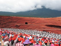 Red Cap over the White Man. Impression Lijiang directed by famous Chinese director Zhang Yi Mou presents a traditional love story of Yunnan Lijiang.  There are Royalty Free Stock Photo