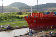 Red Cap Stewart container ship entering in the basin of Miraflor Stock Photos