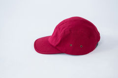 Red cap on white background Royalty Free Stock Photography