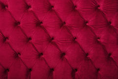 Red capitone tufted fabric upholstery texture Royalty Free Stock Images