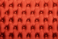 Red capitone tufted fabric upholstery texture Stock Image