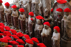 Red capped statues. Japanese red capped stone statues Stock Photo