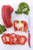 Red capsicum peppers on white wood table. Stock Photography