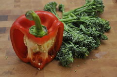 Red Capsicum on Wood Chopping Board Royalty Free Stock Photography
