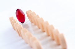 Red Capsule on an aisle of tablets Royalty Free Stock Photos