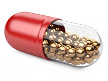 Red capsule with vitamins and minerals. Stock Photo