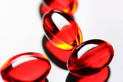 Red capsules Stock Images
