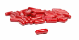 Red capsules Royalty Free Stock Photos