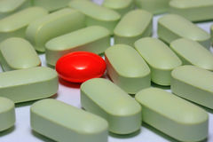 Red capsules of tablets of different colors Stock Photos