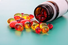 Red capsules of vitamins Stock Photography