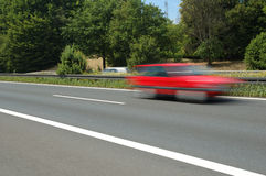 Red car. Fast moving on German highway Royalty Free Stock Image