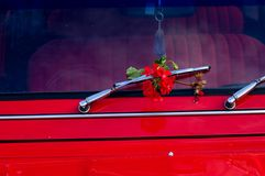 Red car. With red flower Royalty Free Stock Photos