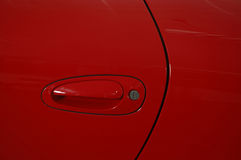 Red car. Door of luxury red car Stock Images