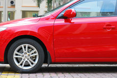 Red Car. A side view photo taken on a red luxury car at a car park Royalty Free Stock Images