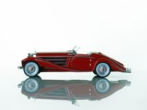 Red car. Re classic car over white Royalty Free Stock Photos