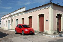 Red car. In old street - Óbidos city - North of Brazil Royalty Free Stock Image