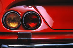 Red Car. Rear fender and taillight of red classic automobile Stock Image