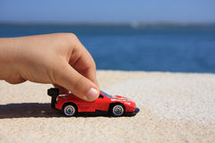 Red car. Close-up of a child hand playing with a red car stock images