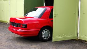 Red Car. Back part of Car parking in a Garage royalty free stock image